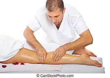 Masseur giving anti cellulite leg massage