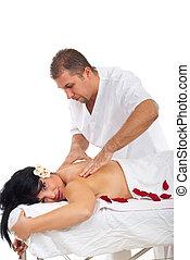 Masseur giving Shiatsu massage to woman
