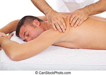 Masseur kneading man back at massage - Professional masseur...
