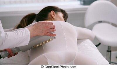 Masseur makes apparatus anti-cellulite massage in the ...
