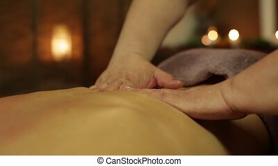 Masseur makes massage with oil for girl