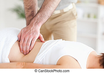 Masseur massaging a woman