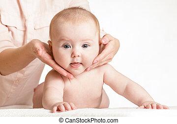 masseur massaging baby girl
