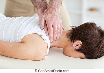 Masseur massaging customer's neck