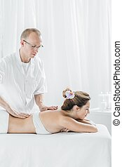 Masseur therapist and female customer