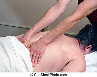 masseuse massaging woman's back