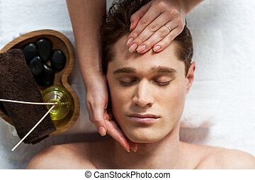 Masseuse doing facial massage - Facial massage in the spa ...