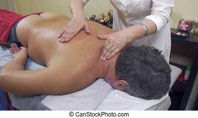 Masseuse press neck, shoulder of adult fat man. Therapeutic...