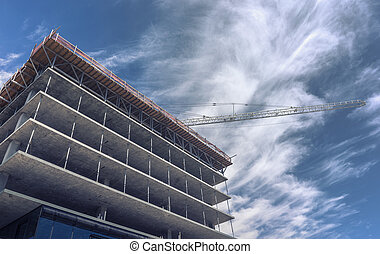 Massive crane assists on high rise