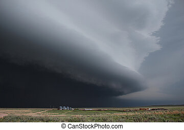 Massive dark supercell thunderstorm - A massive, dark...