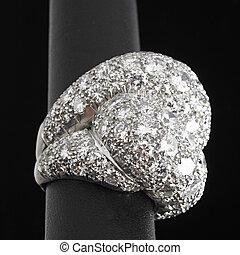 Massive diamond encrusted platinum ring on black ground