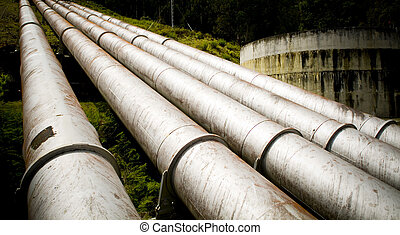 Massive hydro electric pipelines converge up a hill