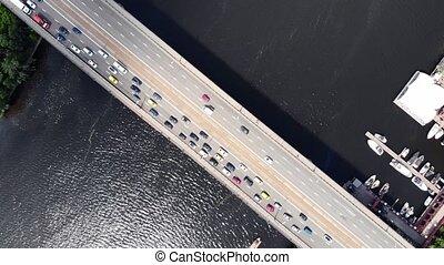 massive traffic jam on gray asphalt bridge over deep river -...