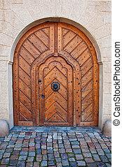 Massive wooden door, image is taken in Prague.