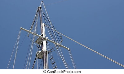 Mast of a Ship - A yacht mast with all the ropes tied on the...