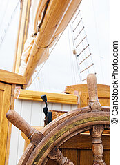 Mast of an ancient sailing vessel - Steering wheel of a...