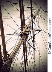 mast of old sailing ship in sepia