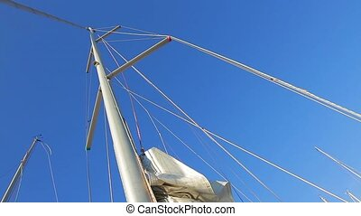 Mast of the yacht. Lowered the sail of boat. Yacht in the...