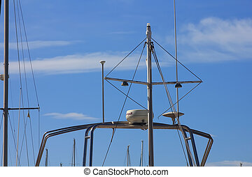 mast with radar and radio antennas small boat