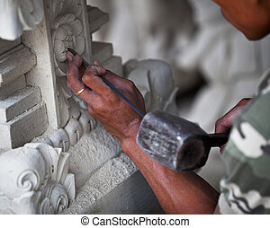 Master at work - stone carving Indonesia, Bali. - Hand of...