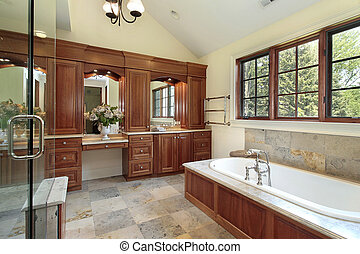 Master bath in luxury home with cherry wood paneling