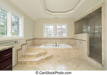 Master bath in new construction home with marble tub