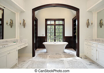 Master bath in luxury home with arched tub area