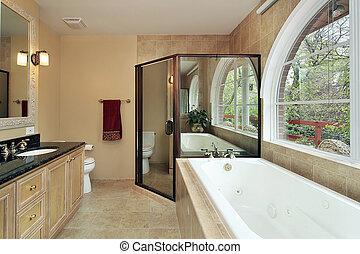 Master bath with arched window - Master bath in suburban...