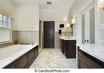 Master bath with dark wood cabinetry