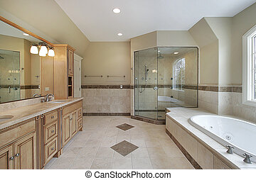 Master bath with glass shower and large tub