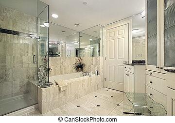 Master bath with glass shower - Master bath in condominium...