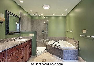 Master bath with green walls - Master bath in suburban home...