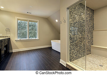 Master bath in luxury home with large shower