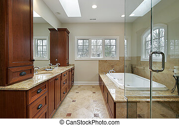 Master bath with glass shower and marble tub