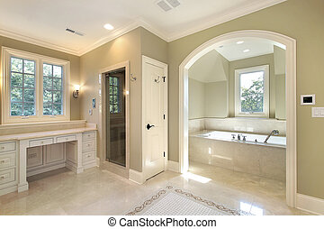 Master bath in new construction home with separate tub