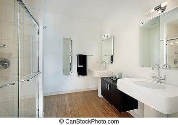 Master bathroom in condominium with glass shower