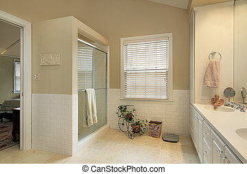 Master bath in suburban home with gold walls