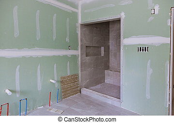 Master Bathroom with new under construction bathroom interior drywall ready for tile