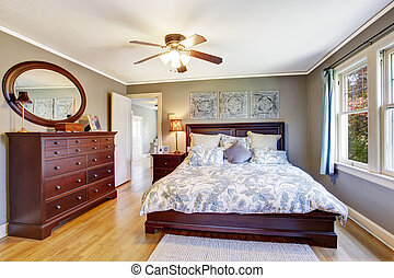 Master bedroom interior with walk-in closet