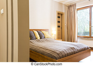Master bedroom with a double bed with pillows