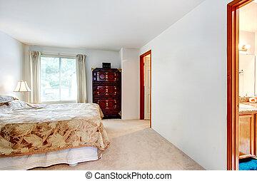 Master bedroom with an antique dresser