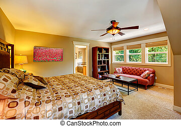 Master bedroom with anitque red couch