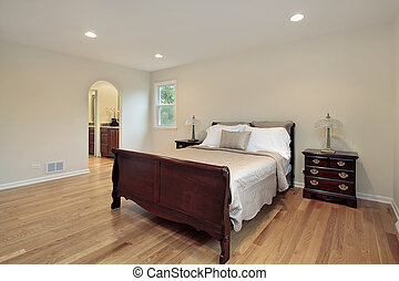 Master bedroom with arched entry - Master bedroom in...