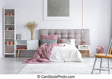 Master bedroom with buttoned headboard