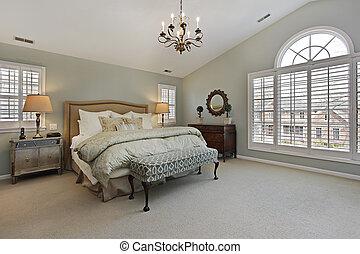Master bedroom with circular window - Master bedroom in...
