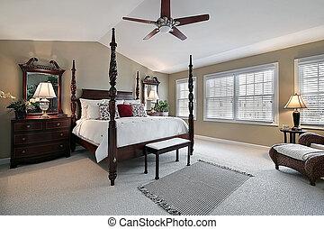 Master bedroom with dark wood furniture