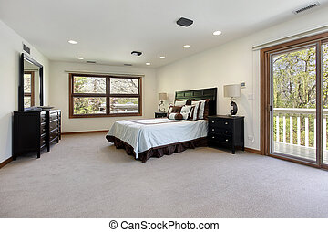 Master bedroom with door to balcony