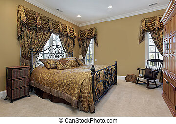 Master bedroom with gold walls - Master bedroom in luxury...