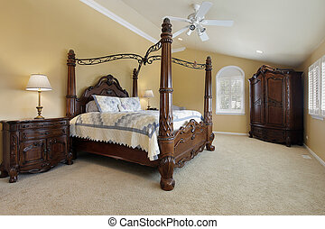 Master bedroom with gold walls