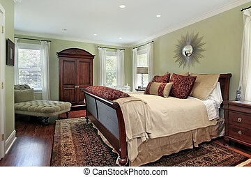 Master bedroom with green walls - Master bedroom in suburban...